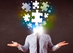 Mann besteht aus Puzzle-Teilen